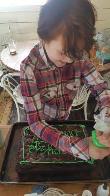 decorating a birthday cake